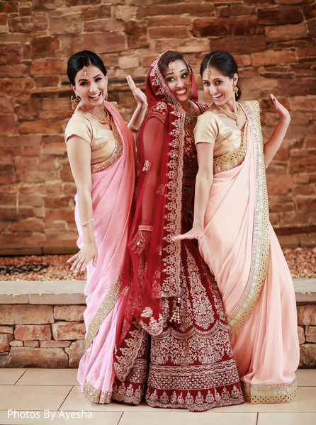 Maharani posing with two of her Indian bridesmaids.