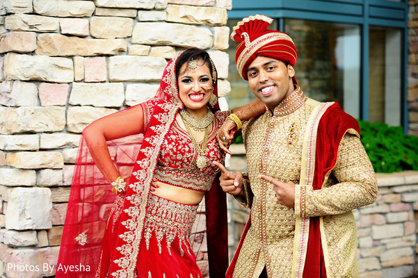 Indian bride and Indian couple posing with wedding clothes.