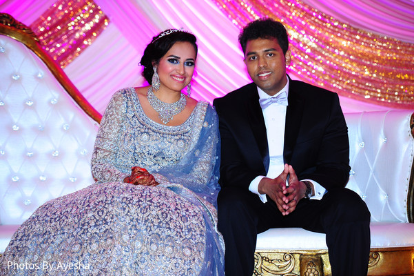 Indian bride in sky blue gown with her Indian groom in suit.