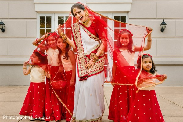 Maharani taking a photo with lovely flower girls.