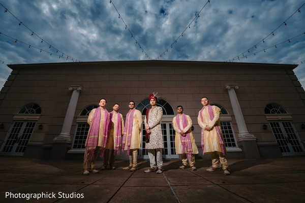 Indian groom with groomsmen posing on with ceremony outfits.