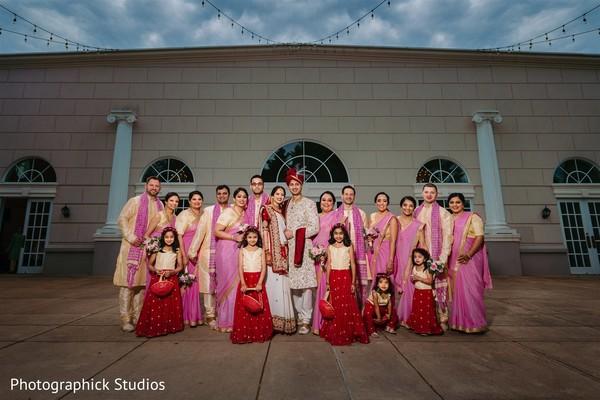 Maharani and rajah posing with flowergirls, bridesmaids and groomsmen