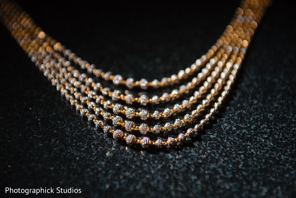 Golden round beads on maharanis necklace .