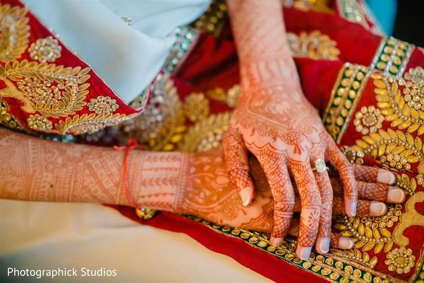 Wonderful Indian bridal mehndi art on her hands.
