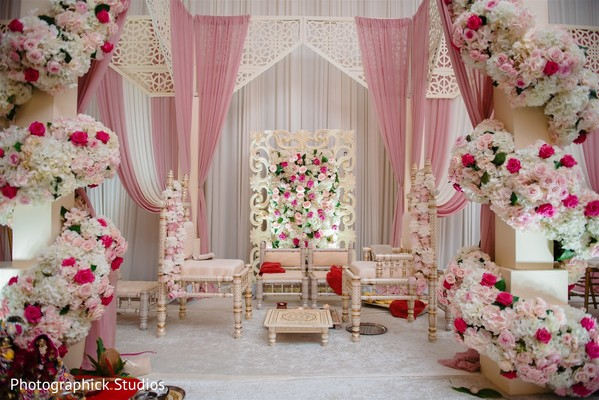 Indian wedding mandap flowers and draping decorations.