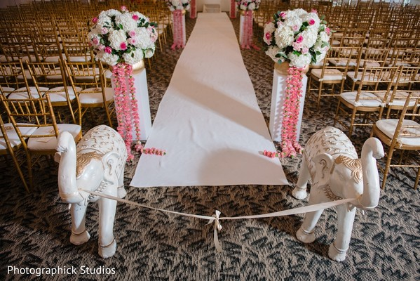 Indian wedding ceremony aisle white and pink decorations.