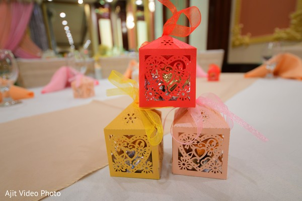 Laser cut Indian engagement red pink and yellow favor boxes.