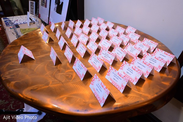Indian engagement white and pink engagement place cards.