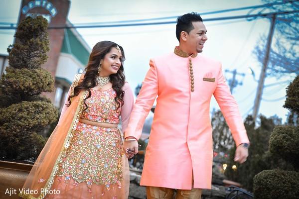Peach color Indian couples engagement fashion.