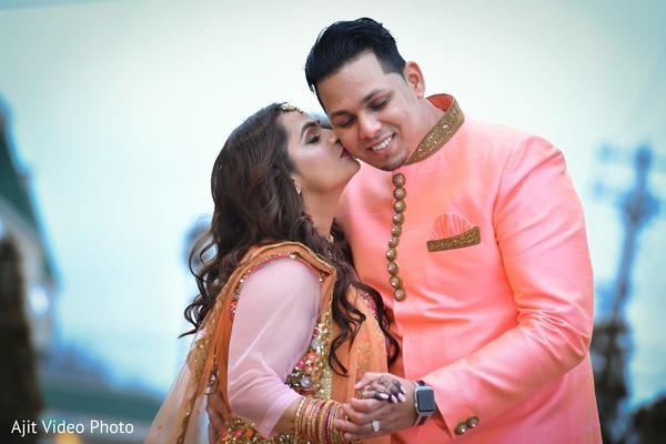 Indian bride kissing her Indian groom capture.