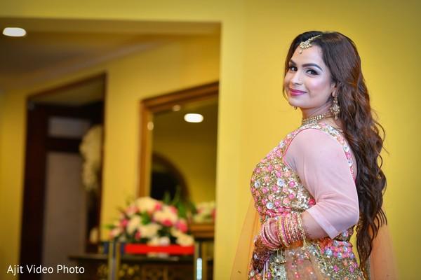 Maharani posing on her engagement pink lehenga.