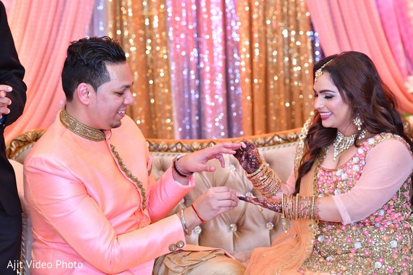 Indian couple exchanging engagement rings.