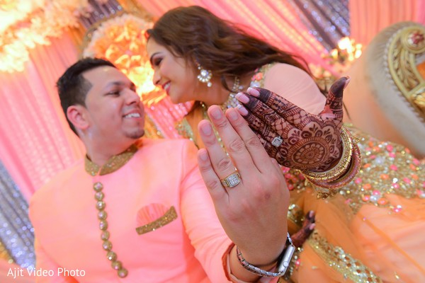 Indian lovebirds with gold engagement rings.