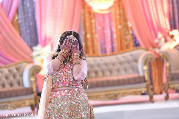 maharani covering her face with her hands .