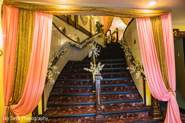 Stairs decorated with flowers and drapes.