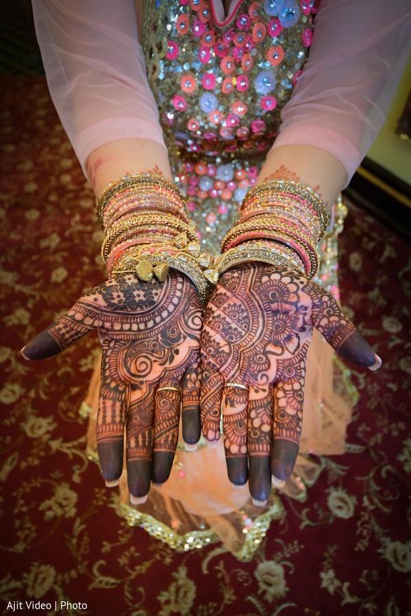 Dark brown Indian bridal henna art.