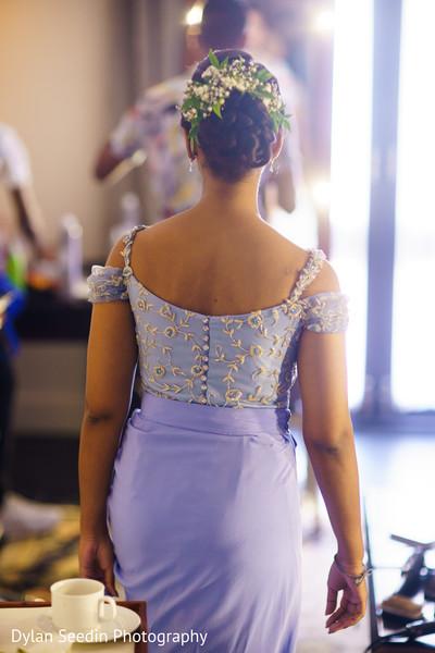 Hair and violet saree design details.