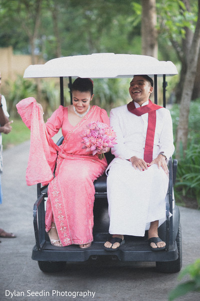 Bride and groom riding the kart.