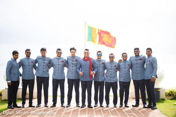 Groom posing with groomsmen with the flag from Sri Lanka.