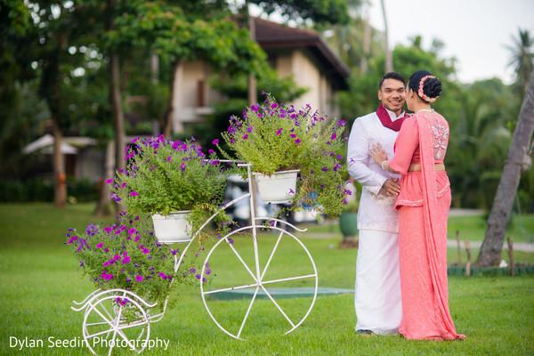 Indian bride wearing the bridal saree posing with Raja.