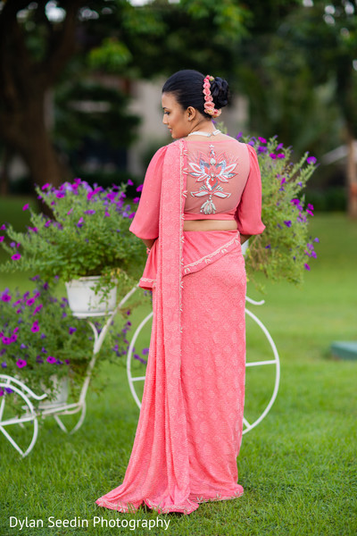 Back design of Maharani's pink bridal saree.
