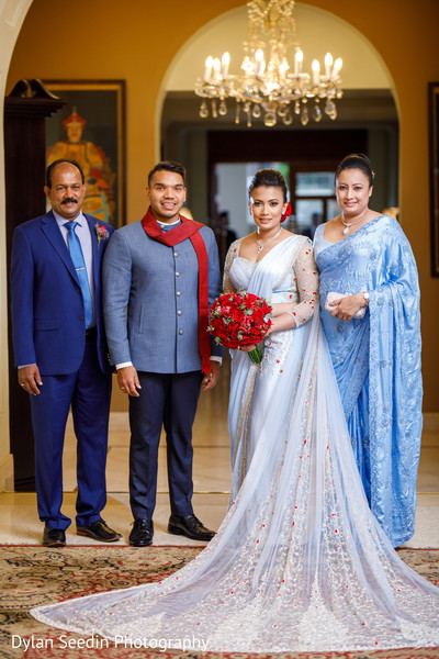 Indian newlyweds posing with special guests at the venue.