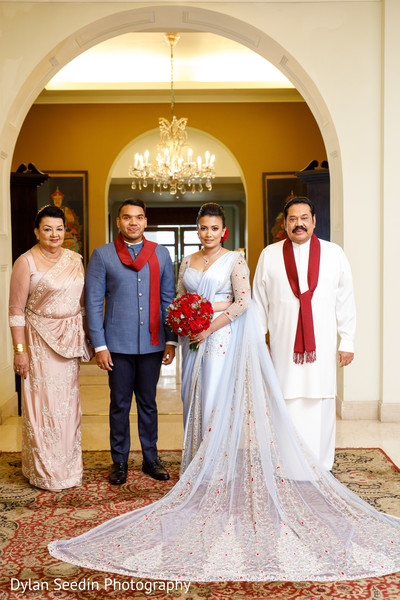 Portrait of the Indian newlyweds with parents.