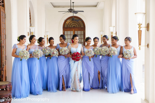 Bridesmaids violet saree designs and bouquet ideas.