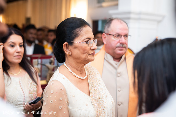 Capture of the Indian wedding guests during the ceremonies.