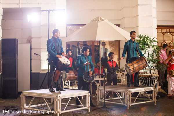 Dhol players performing during the Indian wedding celebration.
