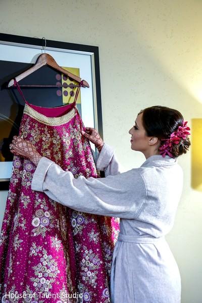 Maharani admiring her lengha.