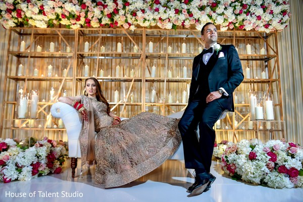 Indian couple wearing reception clothes and posing for photo session.
