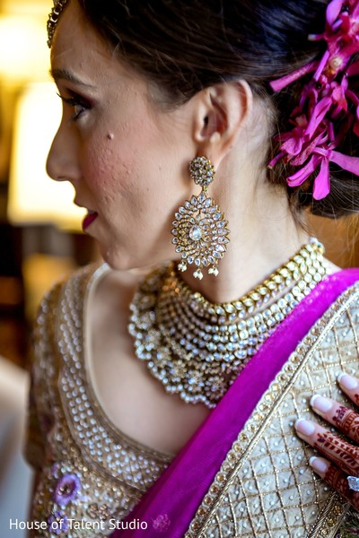 Maharani showing diamond decorated earring.