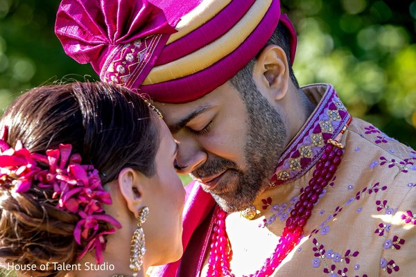 Indian groom with turban face to face with his Maharani.