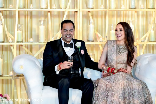 Maharani and her groom smiling in the reception party,