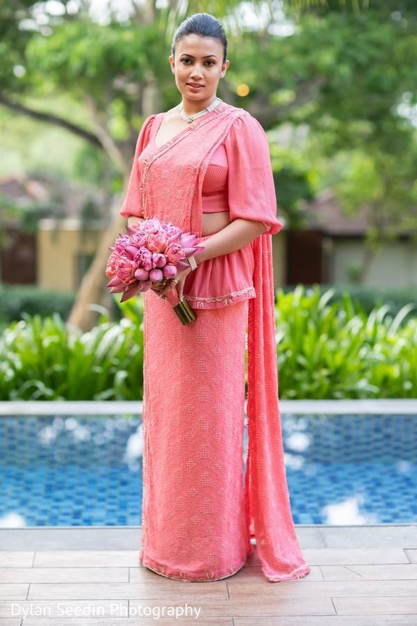 Indian bride wearing a pink modern saree design.