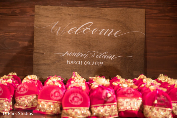 Red and golden favor bags for Indian Wedding reception.