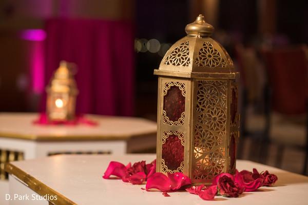 Golden Indian sangeet lantern decorations.