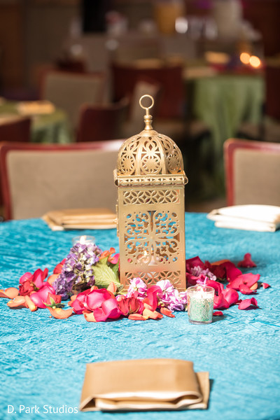 Golden with light coral blue table decorations.