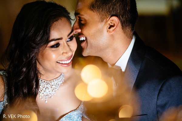 Indian bride and groom smiling during the reception photoshoot.