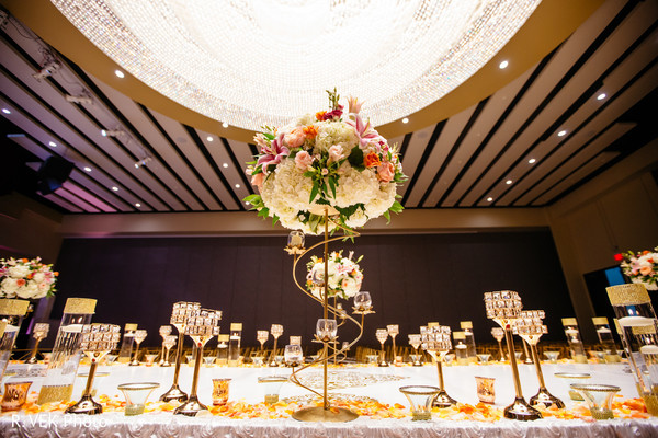 Table setup and floral centerpiece design for the Indian wedding.
