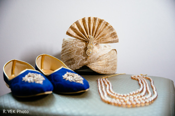 Indian groom's shoes, pagri and jewelry details.
