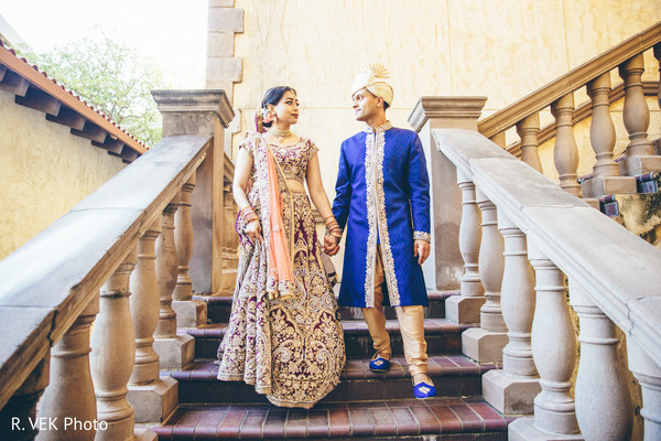 Indian bride and groom on the stairs posing prior to the ceremony.