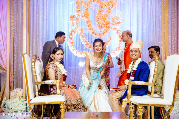 Indian couple with bridesmaid during the Indian wedding ceremony.