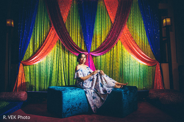 Indian bride posing for pictures during Sangeet.