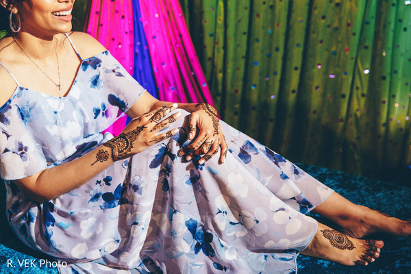 Indian bride's lengha and henna designs.