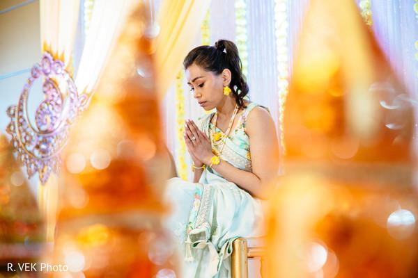 Indian bride having a spiritual moment during the pre-wedding rituals.