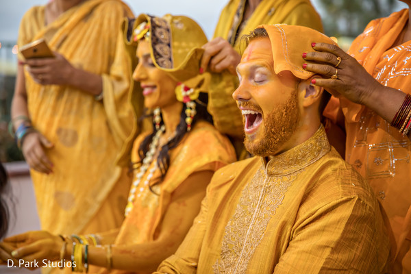 Indian couple cover all over with turmeric paste ritual.