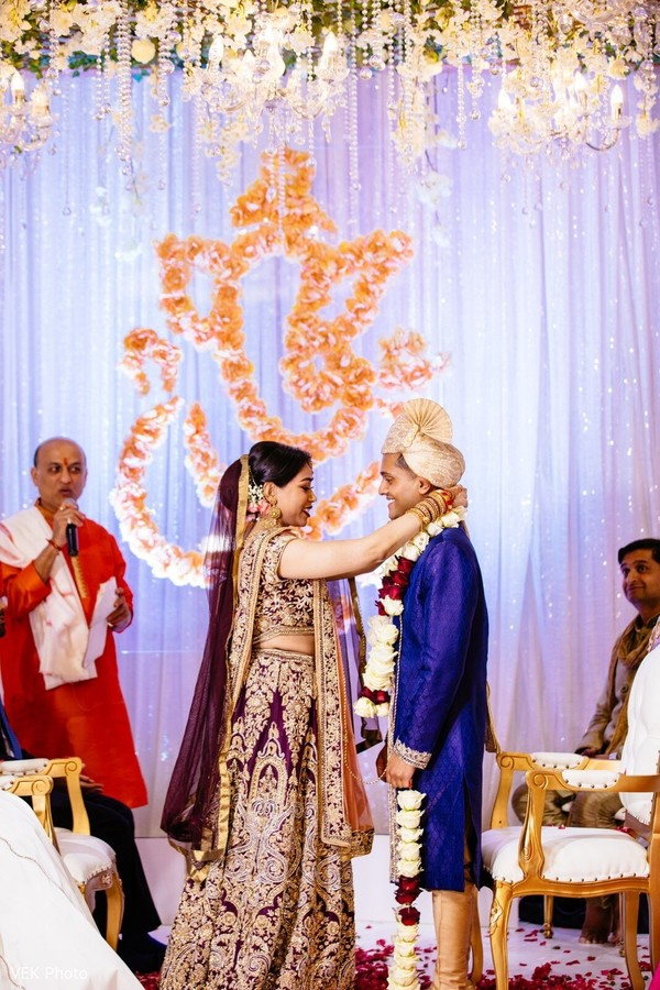 Maharani putting the garland on the Raja during the ceremony.