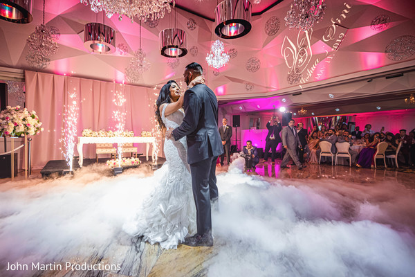 The newlyweds having fun during their first dance